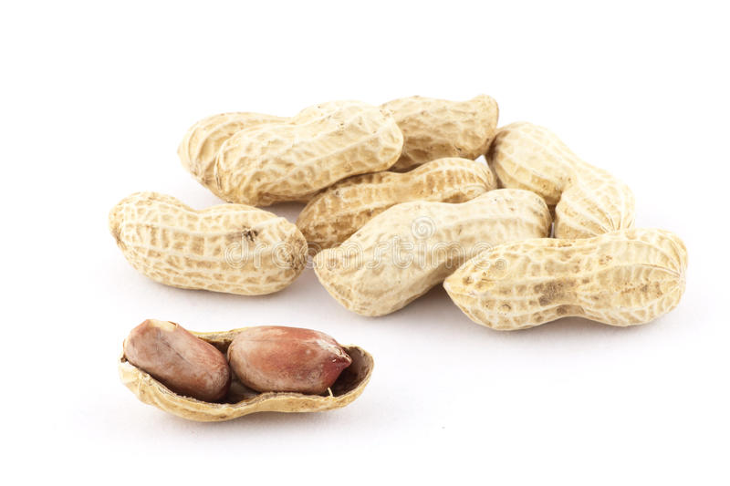 Groundnut. Opened groundnut in shallow depth of field royalty free stock photo