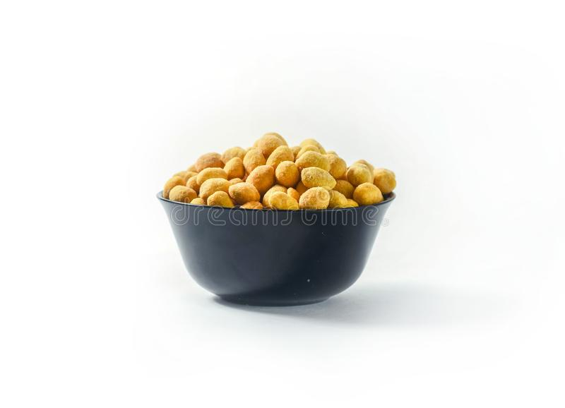 Groundnut with glaze. Groundnut with yellow glaze in bowl on white background isolated royalty free stock photo