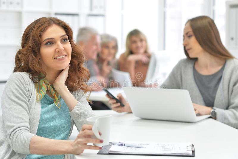 Portrait of group of active business people working stock photos