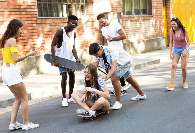 Group of active teenagers making recreational activity in an urban area. Portrait of group of active teenagers making recreational activity in an urban area stock photos