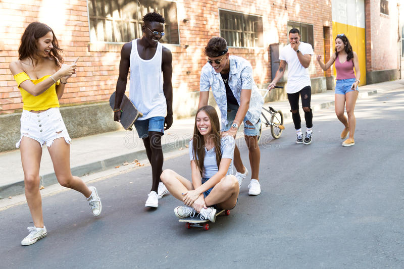 Group of active teenagers making recreational activity in an urban area. Portrait of group of active teenagers making recreational activity in an urban area stock photography