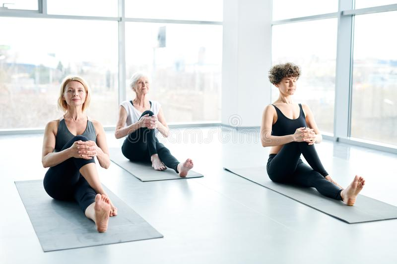 Women on mats stock photography