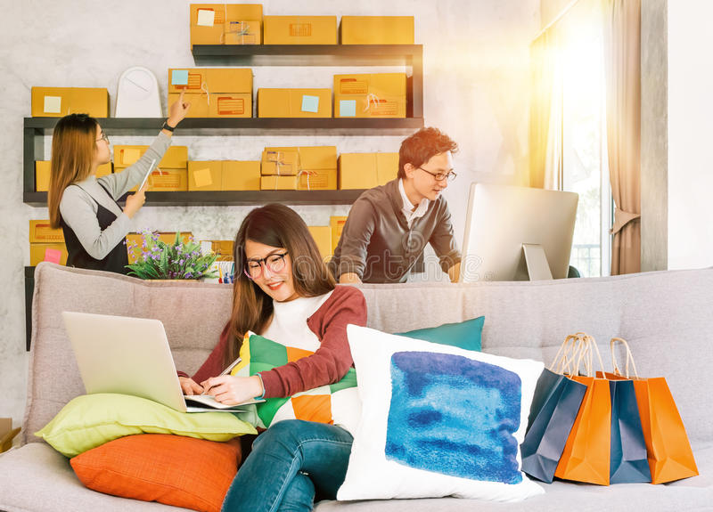 Group of active young people working on startup small business at home. Online marketing shopping delivery or home business teamwork concept royalty free stock image