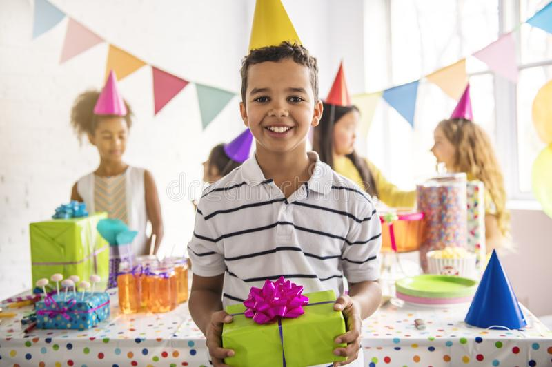 Group of adorable kids having fun at birthday party. African child on the front. A Group of adorable kids having fun at birthday party stock images