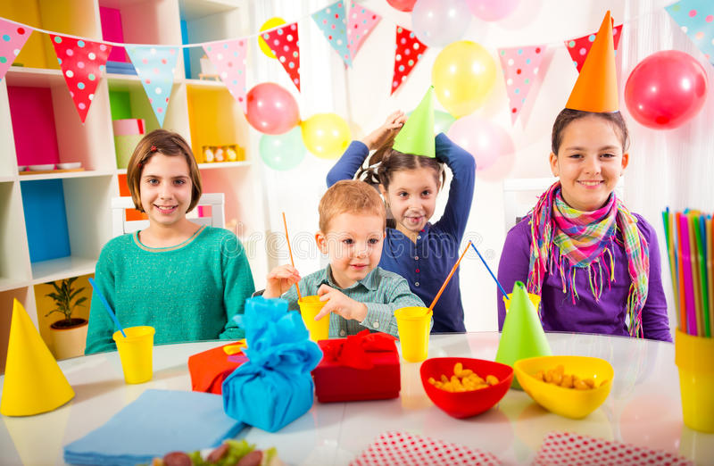 Group of adorable kids having fun at birthday party, selective royalty free stock image