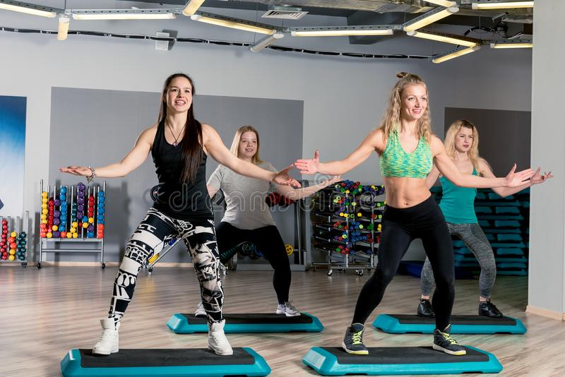 Group aerobics with a coach. In the gym stock photography