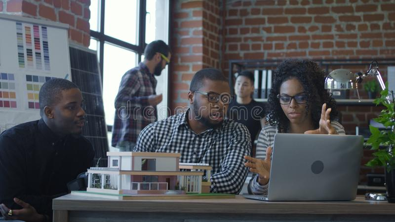 Ethnic colleagues creating futuristic accommodation stock image