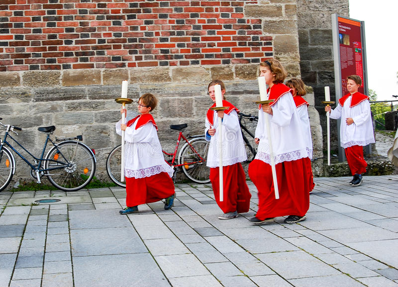 A group of Altar Boys leave church on catholic holiday Mary's Asumption stock image