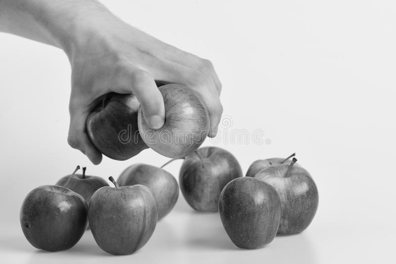 Group of apples placed on light grey background. Apples in fresh and juicy color. Vitamins and fitness concept. stock photo