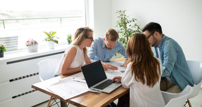Group of architects and business people working together and brainstorming. Group of business people working together and brainstorming royalty free stock image