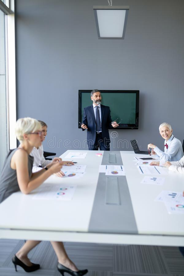 Group of architects and business people working together and brainstorming stock images