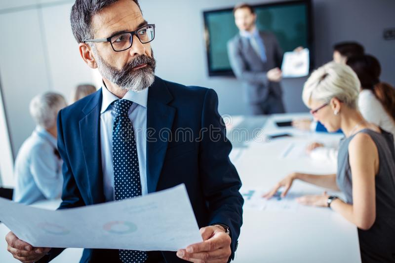 Group of architects and business people working together and brainstorming. In office stock images