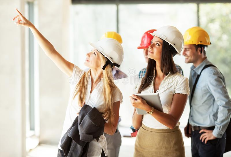 Group of architects and experts discuss about construction project. royalty free stock photography