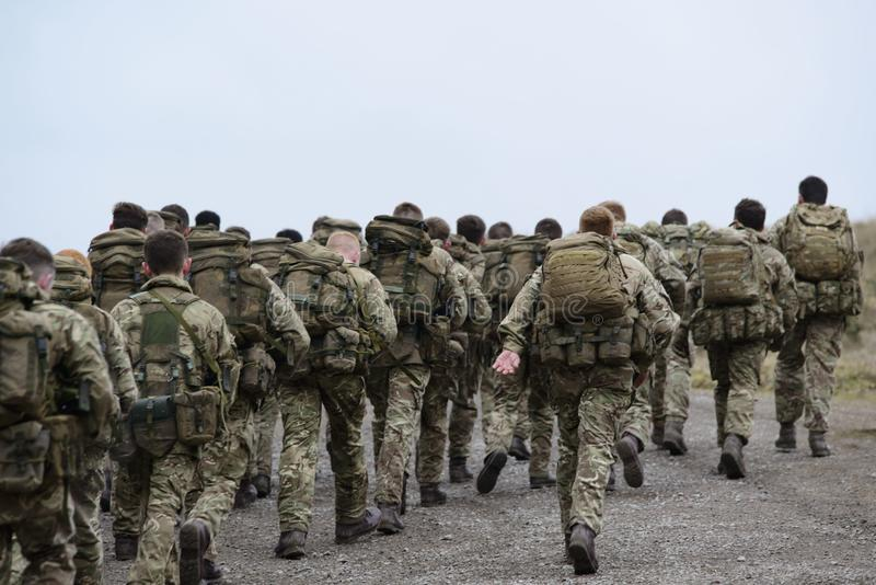 Group of Army Walking stock photos
