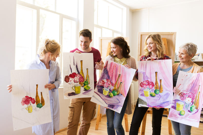 Group of artists with pictures at art school stock photos