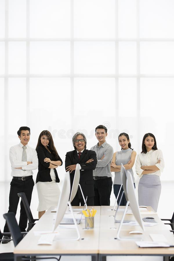 Group of 6 Asaina business people standing together in modern of stock photos