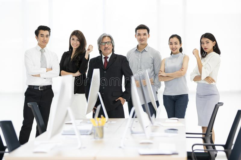 Group of 6 Asaina business people standing together in modern of stock photography