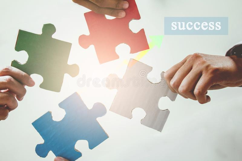 Group  asian business  of hands holding Primary colors jigsaw teamwork stock images