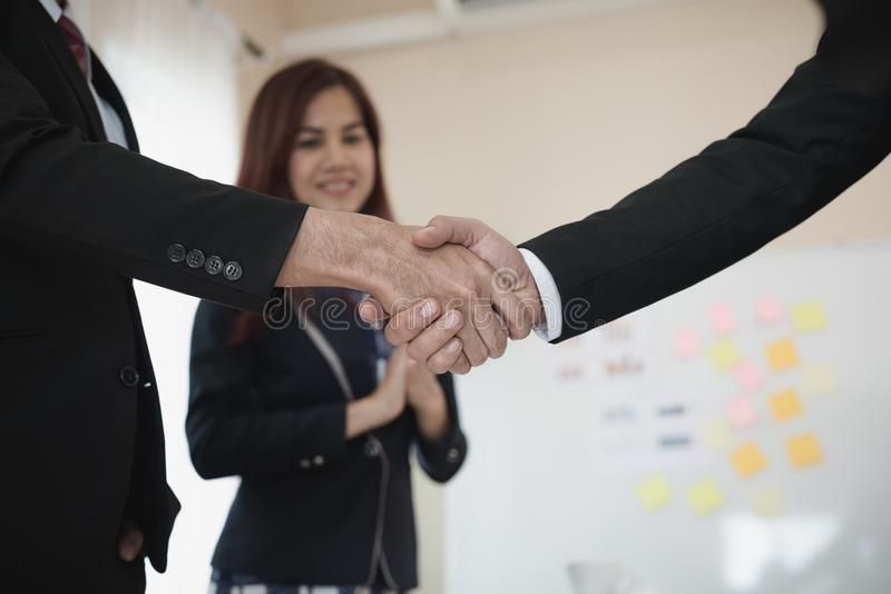 A group of Asian Business handshake of congratulations on meeting the business achieve success. royalty free stock images