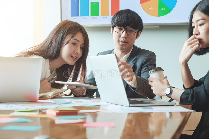 Group of asian Business People Analyzing Statistics Business Doc stock photos