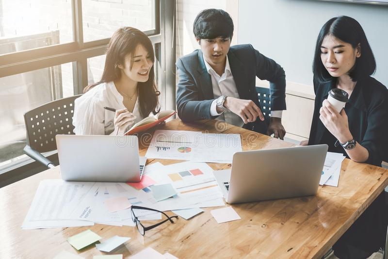 Group of Asian Business People with casual suit are working with stock photo