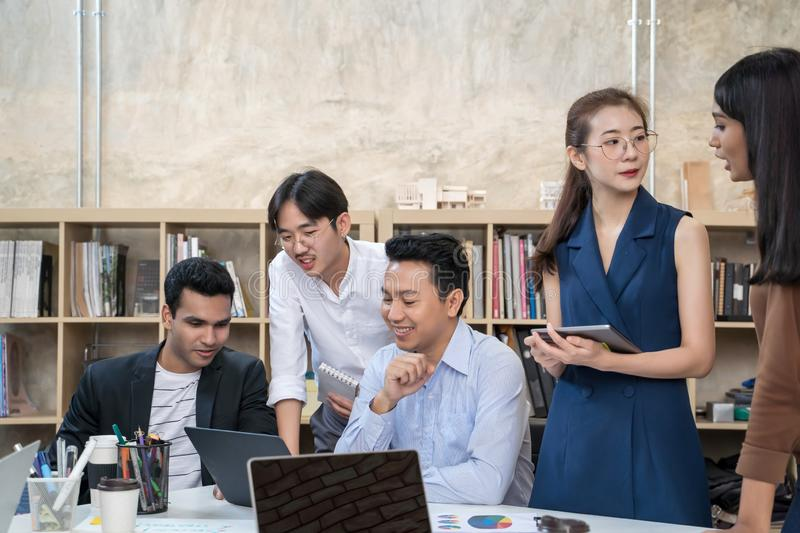 Group of Asian business people team meeting in modern office working design planning and ideas concept. stock image