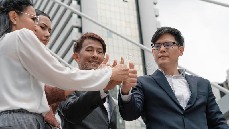 Group of asian business people thumb up together to show teamwork royalty free stock photography
