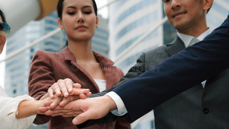 Group of asian business people touch hands together to show team spirit stock photography