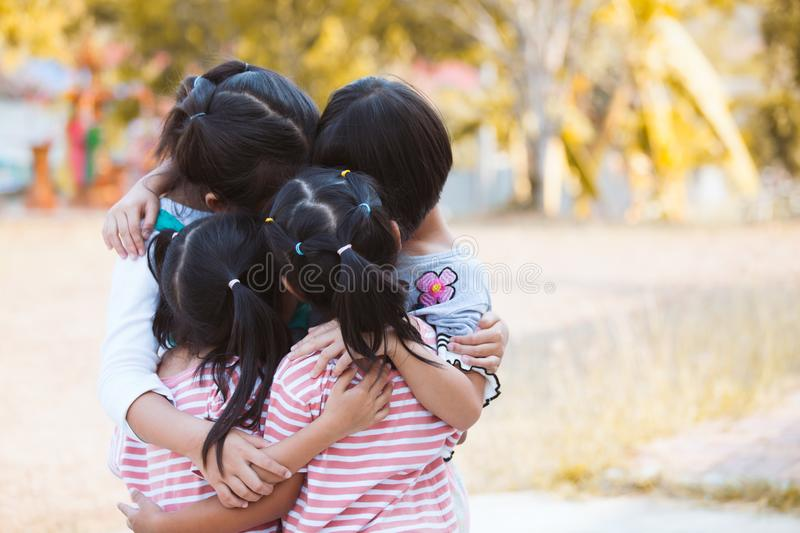 Group of asian children hugging and playing together stock photography