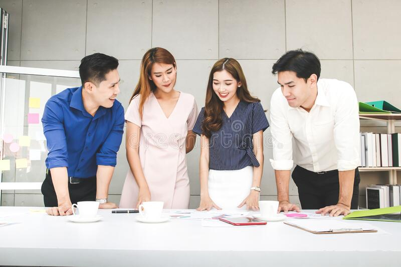 Asian group of colleagues meeting to plan projects for business development. Group of Asian colleagues meeting to plan projects for business and organization royalty free stock photography