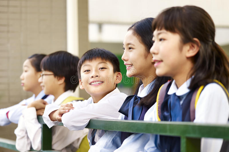 Group of asian elementary schoolchildren royalty free stock photo