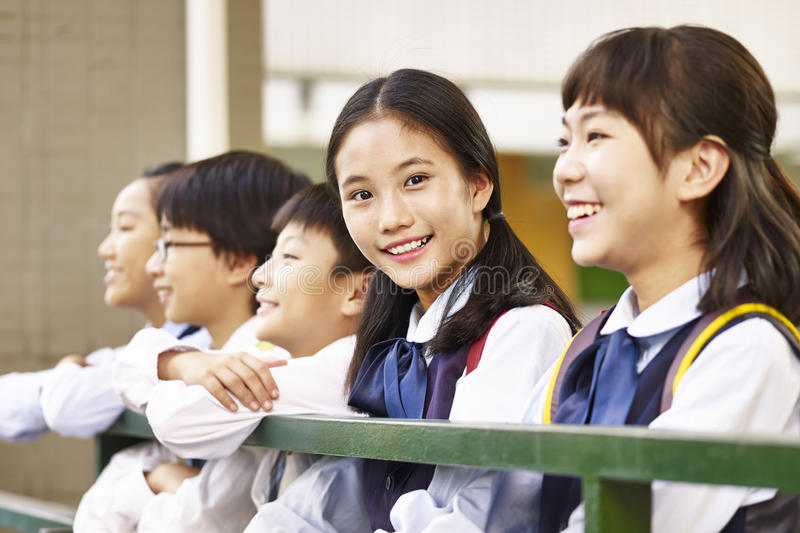 Group of asian elementary schoolchildren royalty free stock image