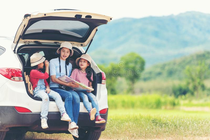 Group asian family children checking map and pointing on the car adventure and tourism for destination and leisure trips travel fo stock photography