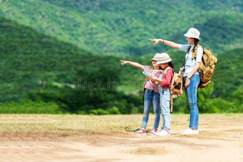 Group asian family children checking map and pointing in the jungle adventure and tourism for destination leisure trips for educat stock image