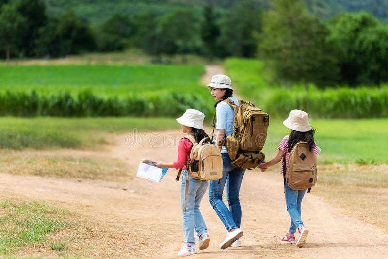 Group asian family children walking in the jungle adventure camping. Student tourism traveling destination leisure trips for educa stock images