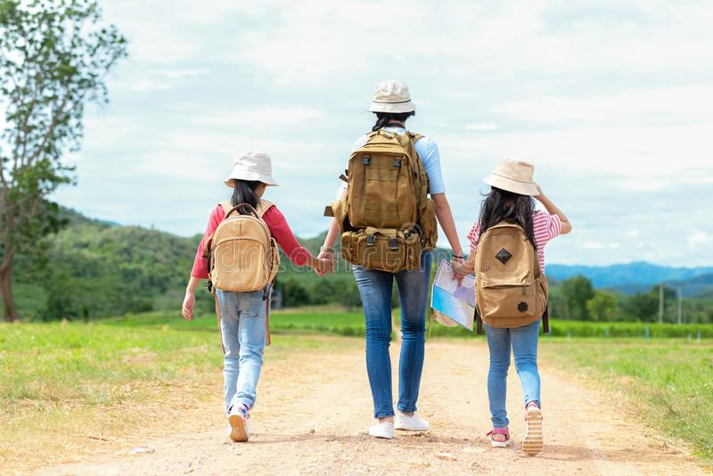 Group asian family children walking in the jungle adventure and tourism for destination and leisure trips for education and relax royalty free stock photography