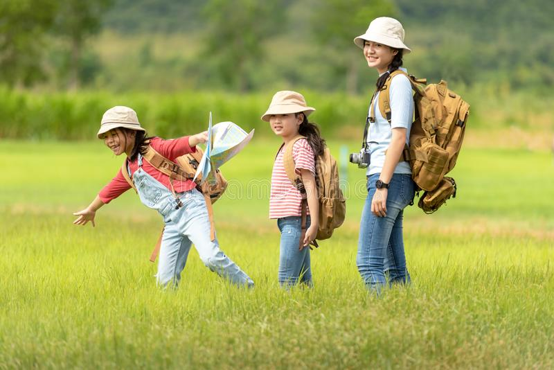 Group asian family children walking in the jungle adventure and tourism for destination and leisure trips for education and relax royalty free stock image
