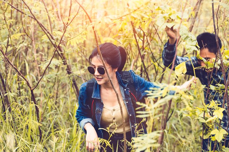 Group of Asian friendship adventure in forest jungle view background. Girl leading tourism team in nature. People lifestyle travel stock image