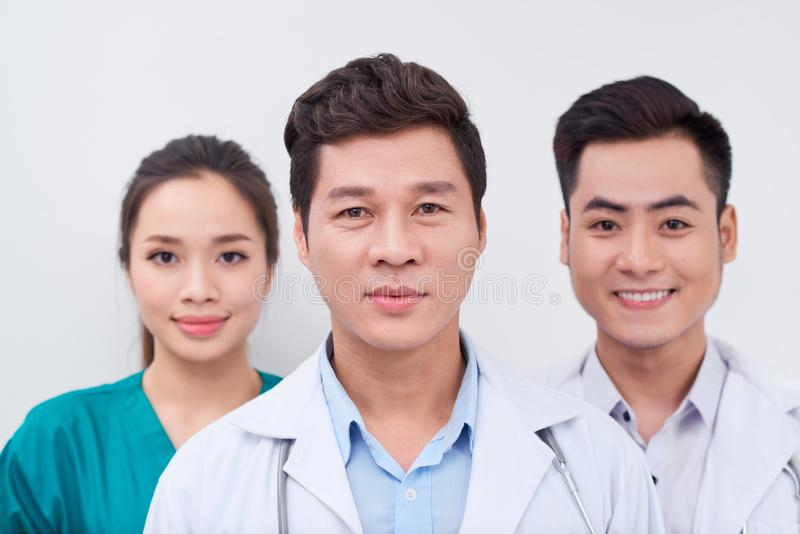 Group of Asian medical workers/ doctors and nurse smiling at camera royalty free stock images
