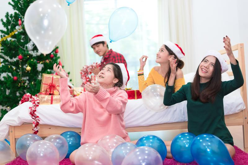 Group of Asian people are throwing the balloons for celebrating Christmas and New year. Holiday and party concept stock photography