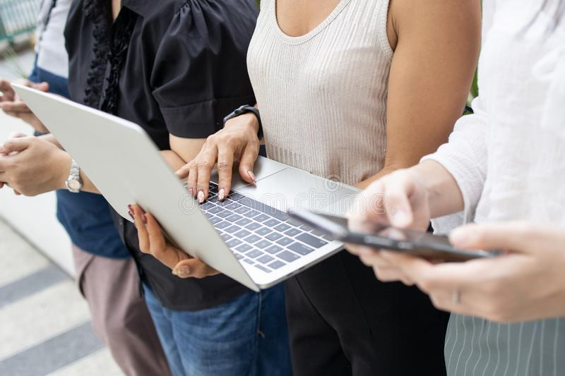 Group asian people using devices smartphone and laptop royalty free stock image