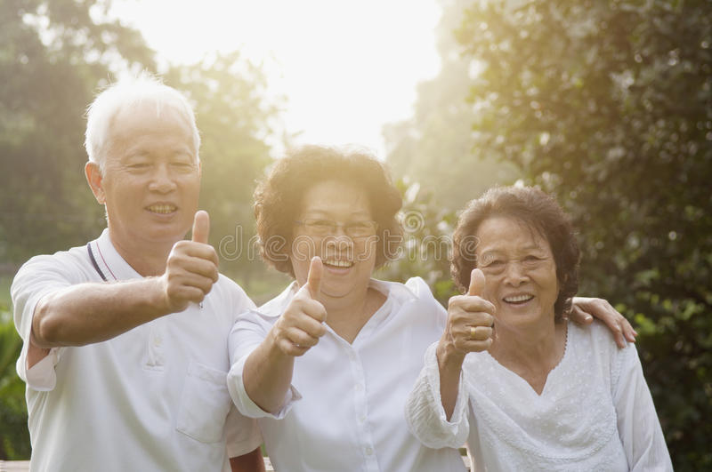 Group of Asian seniors giving thumbs up royalty free stock images