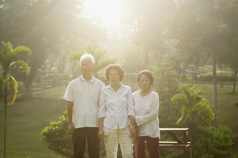 Group of Asian seniors having fun. Portrait of healthy Asian seniors group enjoy retired life at outdoor nature park, in morning beautiful sunlight at background royalty free stock photo