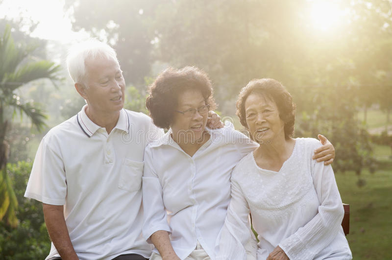 Group of Asian seniors at nature park. Portrait of healthy Asian seniors group having good time at outdoor nature park, in morning beautiful sunlight at stock photo