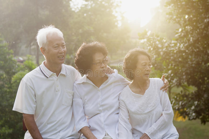 Group of Asian seniors at outdoors. Portrait of healthy Asian seniors group at outdoor nature park, in morning beautiful sunlight at background stock photography