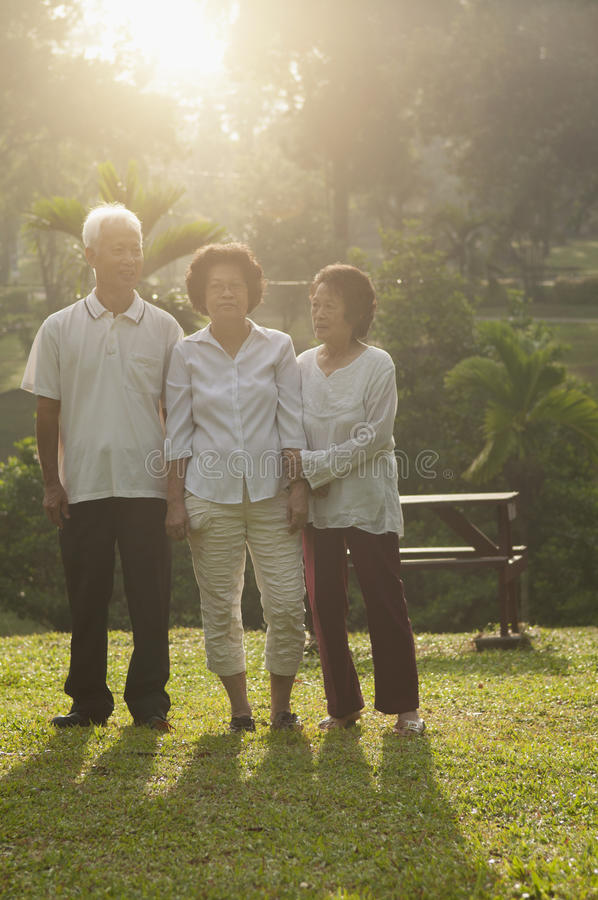 Group of Asian seniors walking at outdoor park stock images