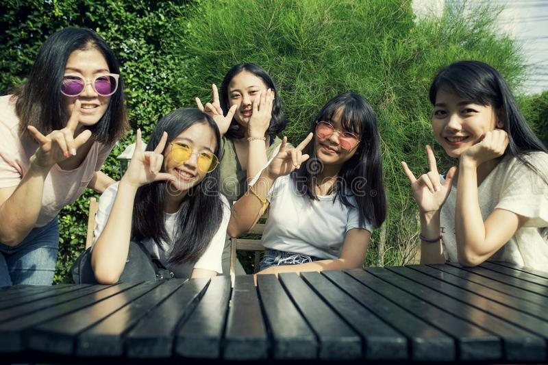 Group of asian teen and younger woman hand sign i love you with happiness smiling face stock photography