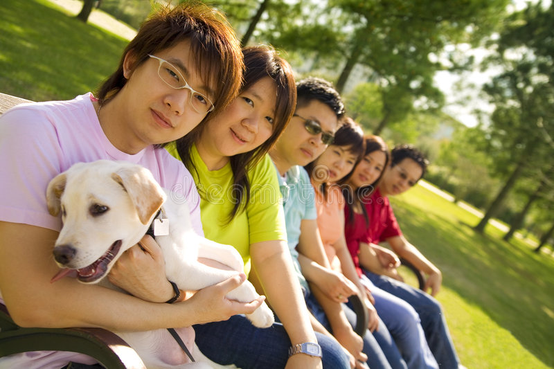 Group Of Asian Teens Sit Outdo stock image