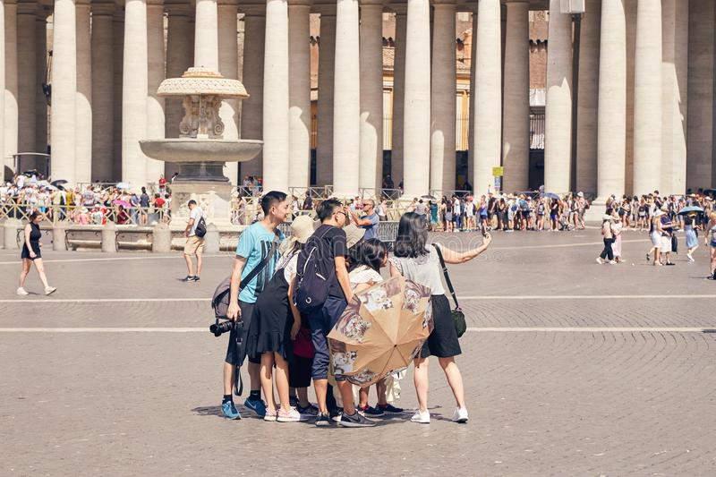 A group of Asian tourists do selfie in the Vatican area next to royalty free stock photography