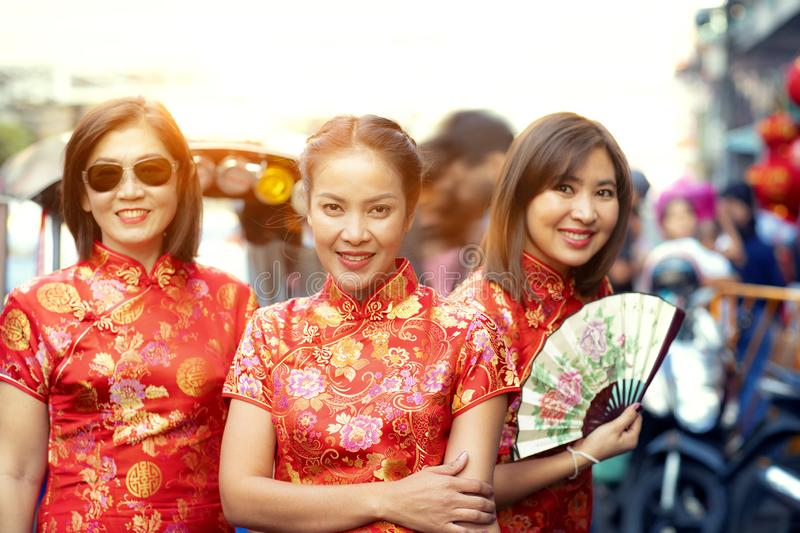 Group of asian woman wearing chinese tradition clothes toothy smiling face happiness emotion and hand sign i love you stock images